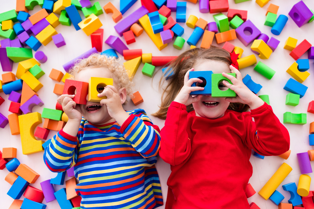 Children playing with coloured blocks